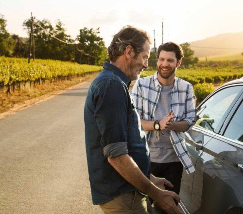 Men-standing-next-to-car-teaser